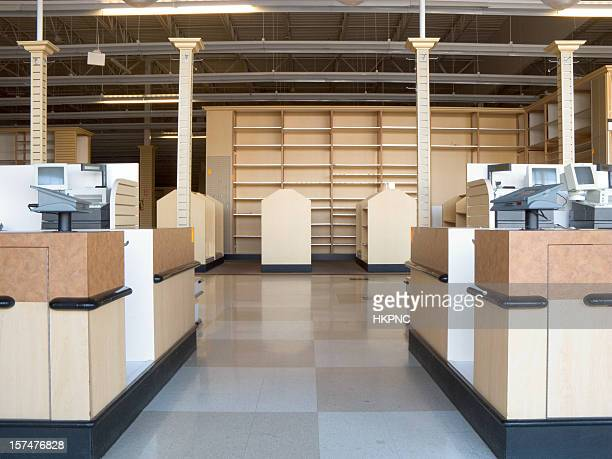 An empty retail store with checkered floors