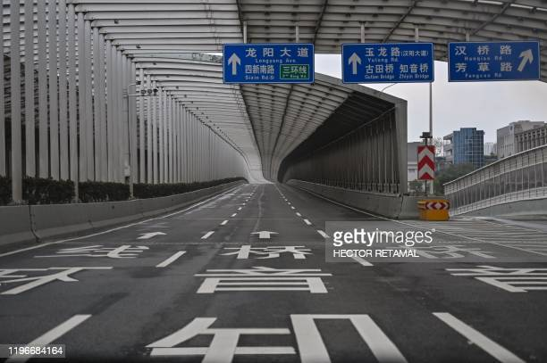 An empty road is seen in Wuhan in China's central Hubei province on January 27 amid a deadly virus outbreak which began in the city. - China on...