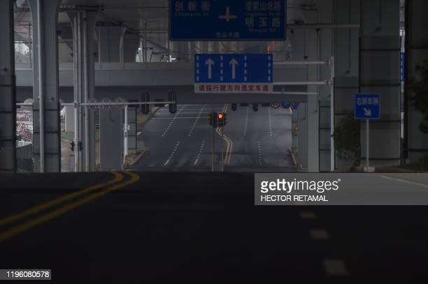 An empty road is seen on the first day of the Lunar New Year in Wuhan in China's central Hubei province on January 25 during a deadly virus outbreak...