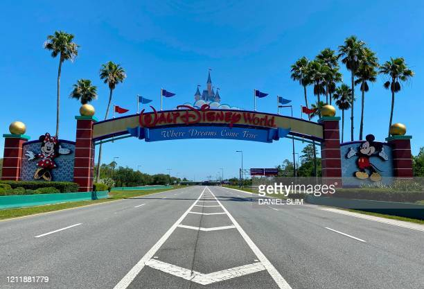 An empty road leads into a deserted Disney resort after it was closed due to the COVID-19 pandemic in Kissimmee, Florida on May 5, 2020.