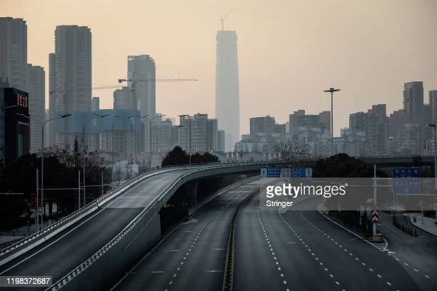 An empty roadway is seen on February 3, 2020 in Wuhan, Hubei province, China. The number of those who have died from the Wuhan coronavirus, known as...