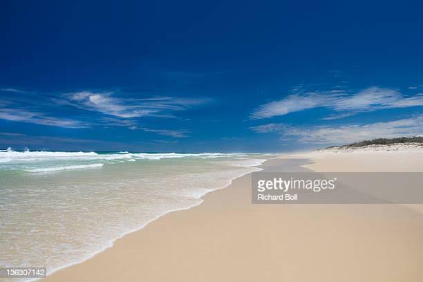 An empty sandy beach on Fraser Island, Australia.