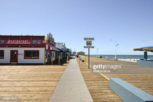 An empty Santa Monica Pier is seen in Santa Monica, California on March 23 as people are encouraged to stay at home to halt the spread of the novel...