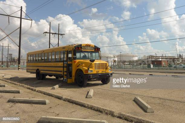 An empty school bus idles amongst a field of chemical plants in the area October 12, 2013. 'Cancer Alley' is one of the most polluted areas of the...
