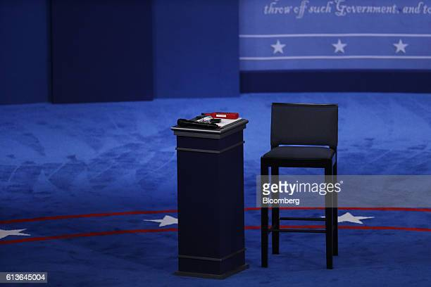 An empty seat and podium stands on stage ahead of the second US presidential debate at Washington University in St Louis Missouri US on Sunday Oct 9...