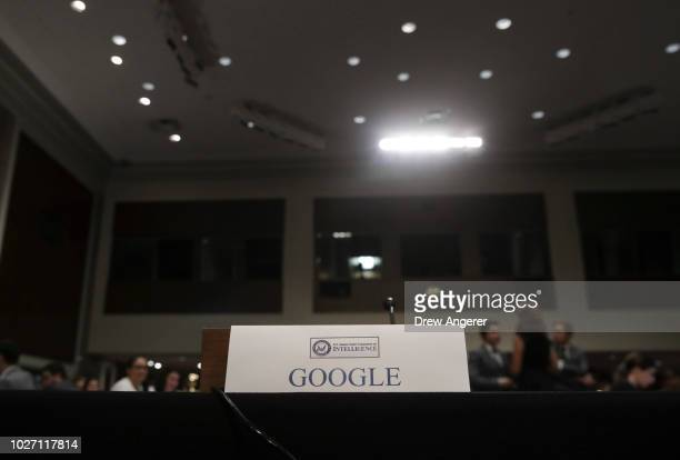 An empty seat for Google is seen during a Senate Intelligence Committee hearing concerning foreign influence operations' use of social media...