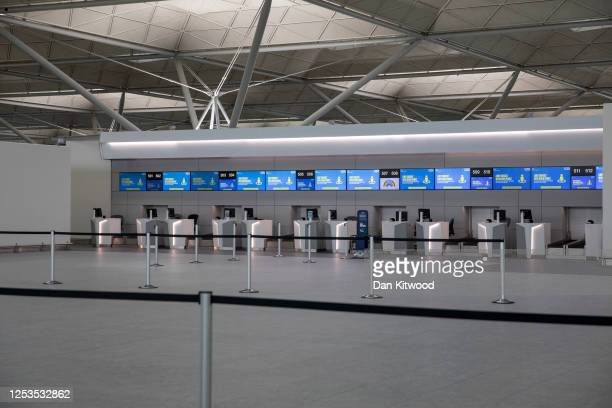 An empty self check-in desk at Stansted Airport on June 30, 2020 in Stansted, United Kingdom. Passengers travelling between the UK and some countries...