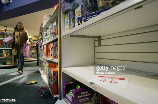 An empty shelf is seen at Toys 'R' Us in Times Square at 600 AM an hour after the store was opened November 23 2007 in New York City Black Friday the...
