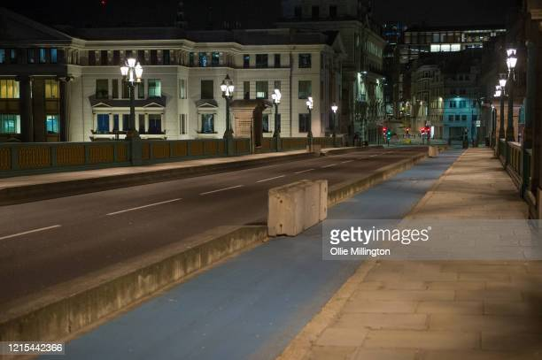 An empty Southwalk Bridge on March 28, 2020 in London, England. British Prime Minister, Boris Johnson, announced strict lockdown measures urging...