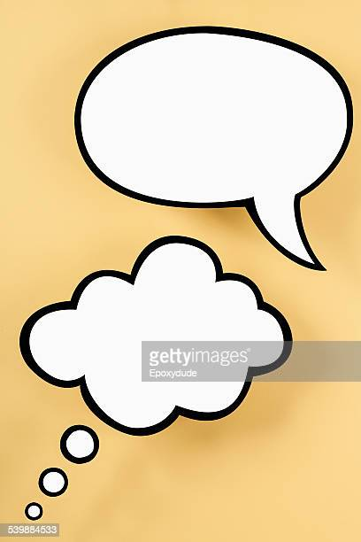 An empty speech bubble and empty thought bubble, yellow background
