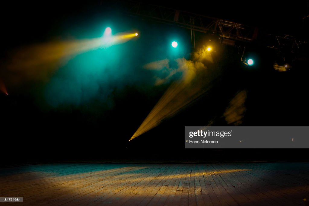 An Empty Stage With Smoke And Lights Stock Photo