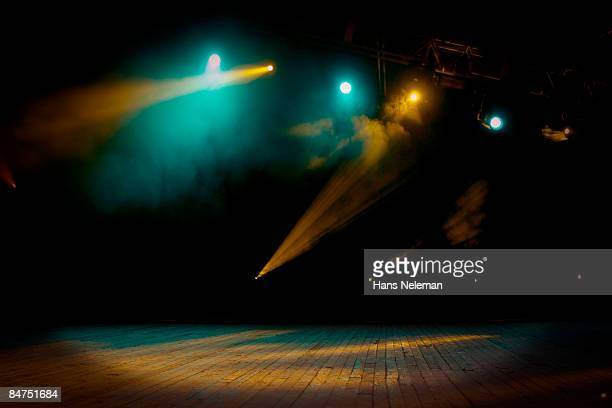 An empty stage with smoke and lights