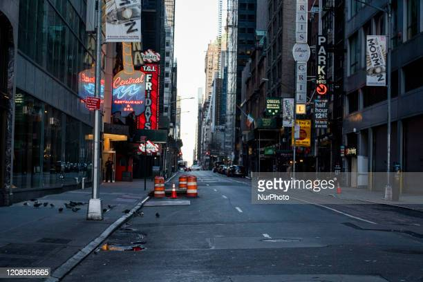 An empty street along Times Square on Friday March 2020 in New York NY The city officially announced the closure of all nonessential businesses and...