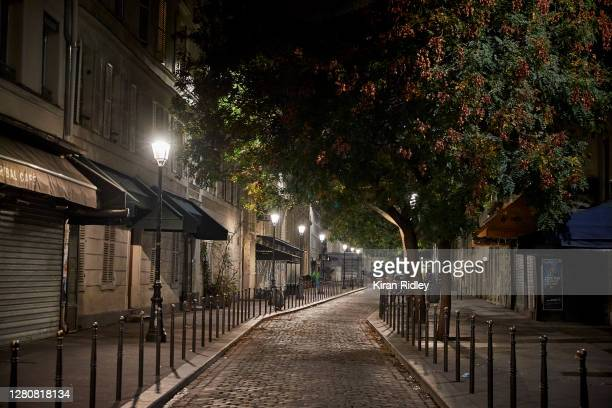 An empty street in Paris as a city wide curfew comes into effect on October 17, 2020 in Paris, France. The nightly curfew, announced by President...