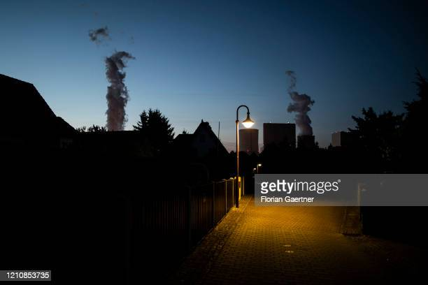 An empty street with street lamp is pictured in front of the coal-fired power plant on April 23, 2020 in Boxberg, Germany. The Boxberg power plant is...