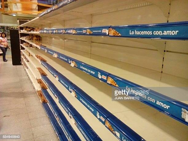 An empty supermarket is pictured in Caracas on May 28 2016 The shortage of basic foodstuffs in Venezuela exceeds 80 percent a survey revealed / AFP /...