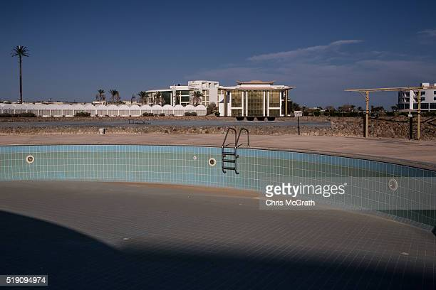 An empty swimming pool is seen at an abandoned resort on April 3 2016 in Sharm El Sheikh Egypt Prior to the Arab Spring in 2011 some 15million...