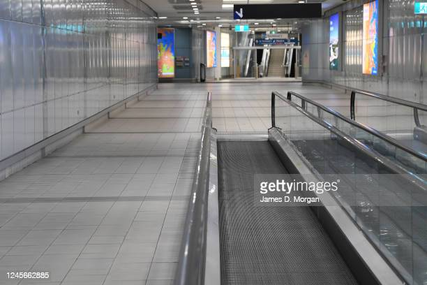 An empty travelator at the domestic airport terminal on June 05, 2020 in Sydney, Australia. Restrictions continue to ease around Australia in...