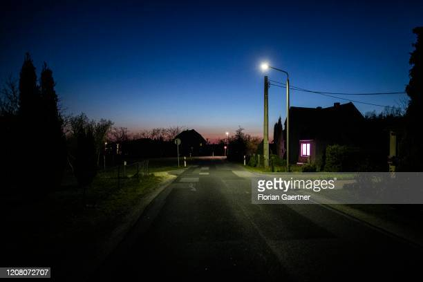 An empty village road is pictured during blue hour on March 23, 2020 in Thraena, Germany.