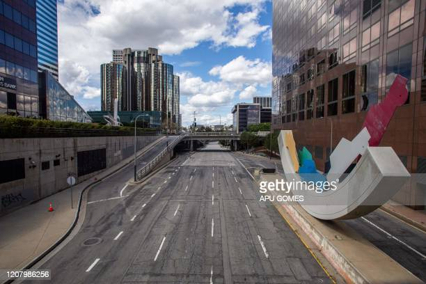 An empty W 4th Street is seen in Downtown Los Angeles on March 22 during the coronavirus outbreak The US president on March 22 said he had ordered...