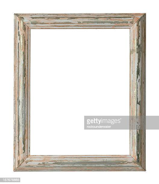 An empty weathered wooden frame on a white background