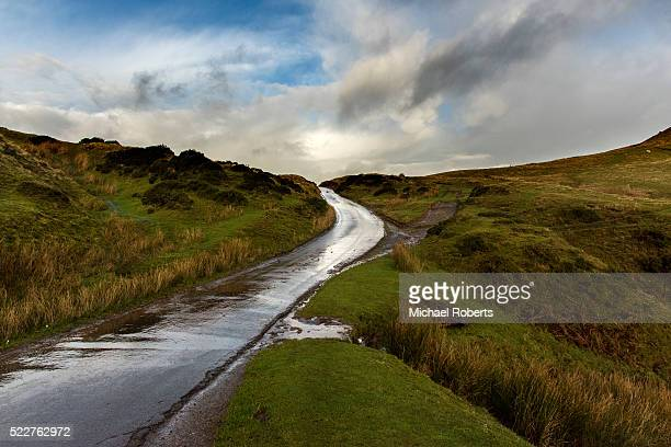 An empty wet road winding through the hills of the Black Mountains, Brecon Beacons national park in Wales