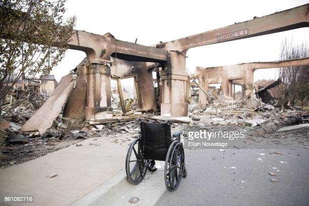 An empty wheelchair is seen in the remains of the Verenna housing development parking structure in the Fountaingrove neighborhood on October 13 2017...