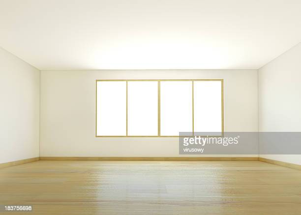 An empty white room with wooden flooring