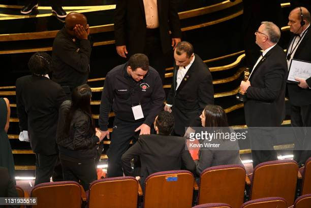An EMT speaks with Rami Malek during the 91st Annual Academy Awards at Dolby Theatre on February 24 2019 in Hollywood California