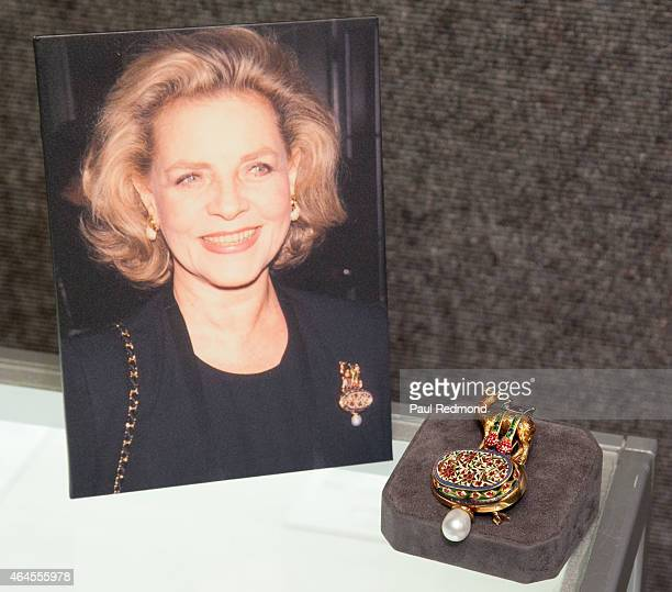 An enameled cultured pearl diamond brooch designed for actress Lauren Bacall by Elizabeth Gage on display at The Lauren Bacall Collection at Bonhams...