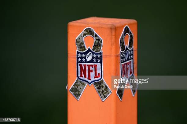 An end zone marker is shown featuring an NFL Salute to Service logo before a game between the Tennessee Titans and Baltimore Ravens at MT Bank...