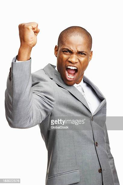 An energetic business man screaming loudly against white background