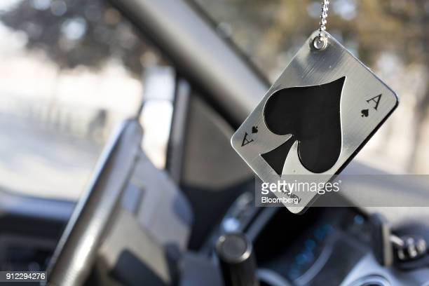 An Energizer Holdings Inc Driven by Refresh Your Car brand air freshener hangs from a rearview mirror in Tiskilwa Illinois US on Tuesday Jan 30 2018...