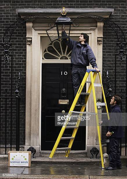 An energy efficient lightbulb is fitted in the lamp above the door of Number 10 Downing Street on March 9 2006 in London