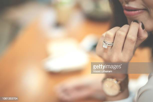 an engagement ring is a ring indicating that the person wearing it is engaged to be married - jewelry stock pictures, royalty-free photos & images