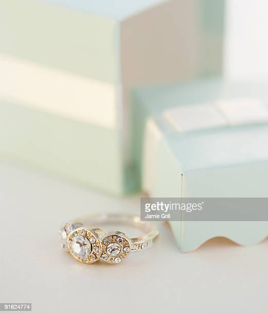 an engagement ring - engagement ring box stock photos and pictures