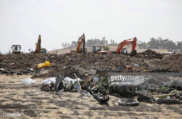 An engine and landing gear lie among the debris at the crash site of Ethiopian Airlines Flight ET 302 on March 12 2019 in Bishoftu Ethiopia All 157...