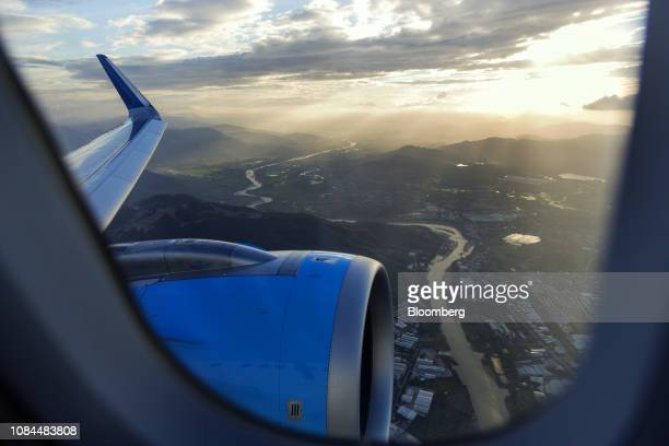 An engine and the carved wing tip of an Airbus SE A321 Neo aircraft is seen through a window on an Airbus SE A321 Neo aircraft operated by FLC Group...