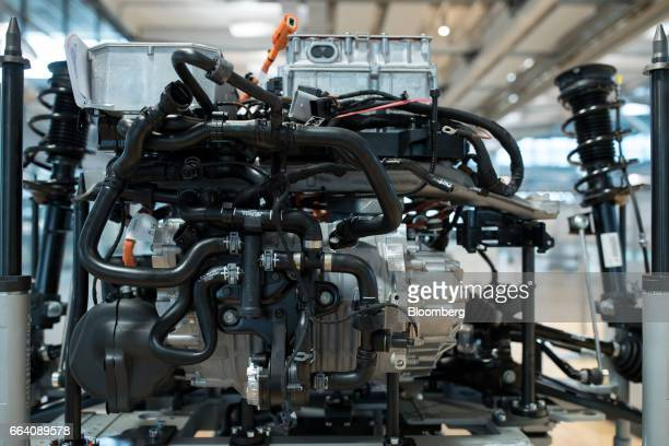 An engine awaits installation into a Volkswagen eGolf electric automobile inside the Volkswagen AG factory in Dresden Germany on Monday April 3 2017...