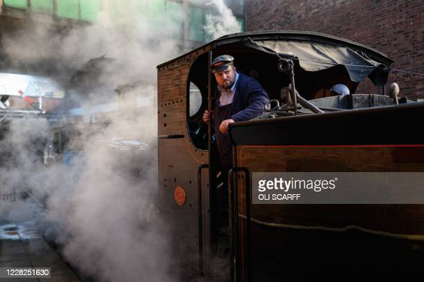 An engine driver prepares a steam train before it runs along the East Lancashire Railway's line from Bury station in northern England on August 29 on...