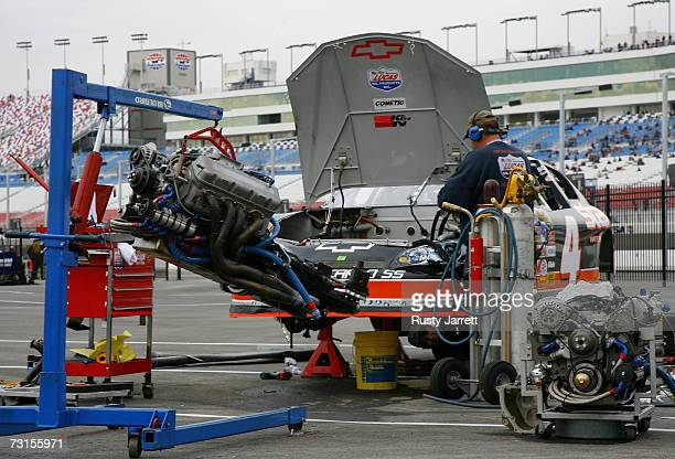 An engine is changed for the State Water Heater Chevrolet driven by Ward Burton during NASCAR testing at Las Vegas Motor Speedway on January 30 2007...