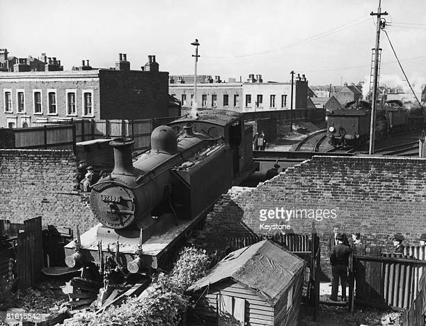 An engine which ran off the turntable at the Southern Region sheds in Nine Elms Wandsworth crashing through a brick wall into a garden in Brooklands...