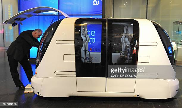 An engineer adjusts a driverless car during a photocall at the Science Museum in London on August 11 2009 The photocall was held to promote a new...