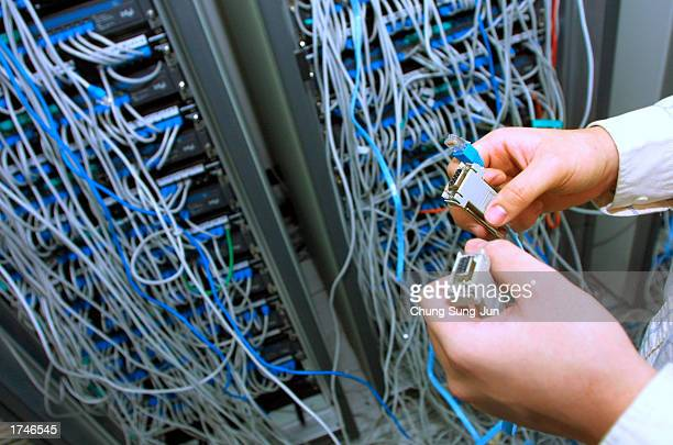 An engineer at South Korea's leading antivirus firm AHNLABCom checks the company's systems after the 'SQL Slammer' computer worm attacked internet...