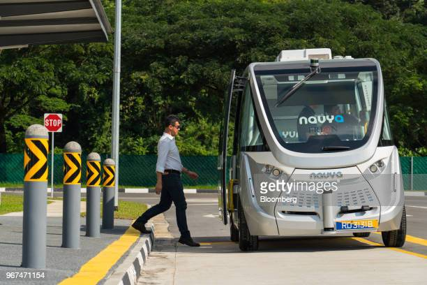 An engineer boards a Navya SAS autonomous electric passenger bus travelling along a test circuit at the Centre of Excellence for Testing Research of...