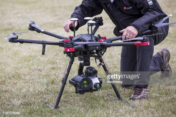 An engineer carries out checks on a Precision Hawk drone targeted at onshore maintenance and checking gas leaks at a BP Plc immersive technology...