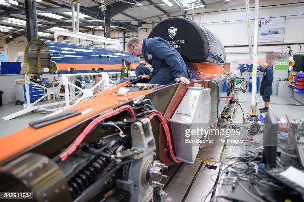 An engineer climbs into the cockpit to fit a footplate at the Bloodhound Technical Centre in Avonmouth as the BLOODHOUND SSC car is prepared for...