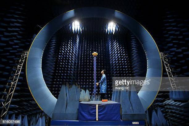 An engineer conducts a test on an antenna in a lab at FiberHome Communication Limited Company on October 21 2016 in Wuhan Hubei province central...