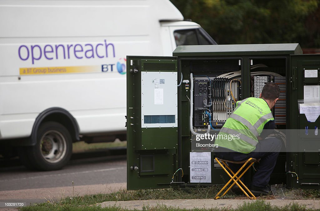 An engineer for BT Openreach part of the BT Group Plc works on a network cabinet in Enfield, U.K., on Thursday, Aug. 5, 2010. BT Group Plc, the U.K.'s largest fixed-line phone company, said first-quarter operating profit climbed 5.5 percent helped by job cuts. Photographer: Chris Ratcliffe/Bloomberg via Getty Images
