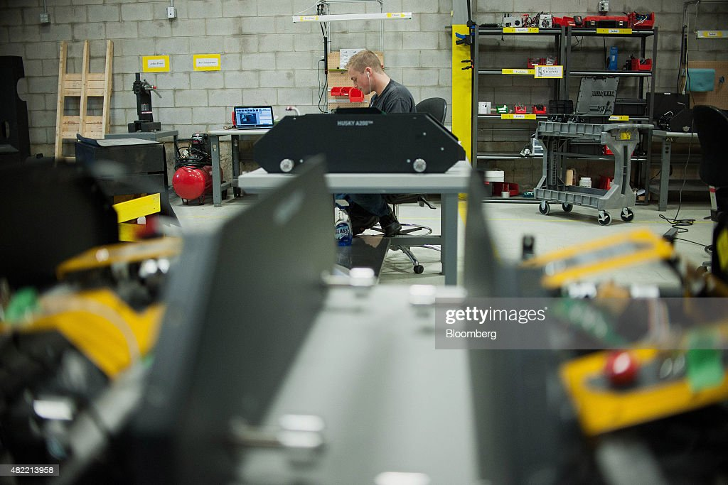 An engineer hand assembles the Husky robot at the Clearpath Robotics Inc. facility in Kitchener, Ontario, Canada, on Friday, July 24, 2015. Clearpath Robotics, Inc. manufactures industrial robot research and development applications in addition to offering guidance, navigation, control, perception, military engineers, educational mobile robots, hardware components, and computer scientists. Photographer: James MacDonald/Bloomberg via Getty Images
